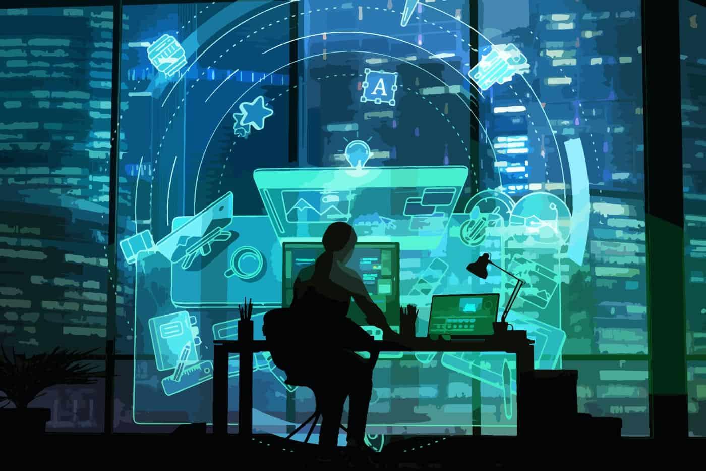 man sitting at desk looking at digital screens